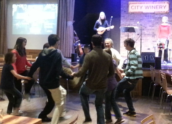 Image of folks dancing to the music of the Ensemble M'chaiya (tm) at the City Winery in Chicago while they still had a Klezmer Sunday Brunch in 2013. © 2013 Modal Music, Inc. (tm) All rights reserved.